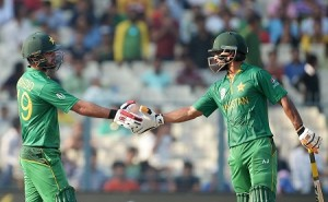 Pakistan's Ahmed Shehzad (L) celebrates with teammate Mohammad Hafeez (R)
